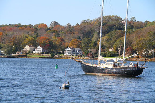 Yawl anchored on the Mystic River CT