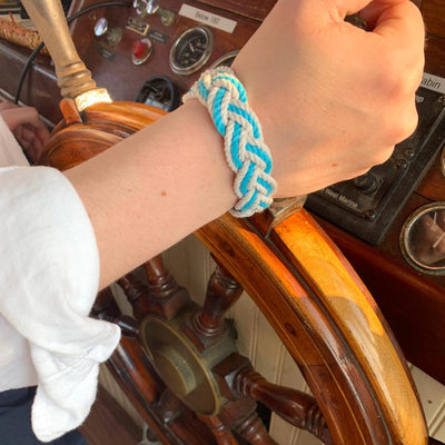 Pilot of the Pearl wearing our nautical sailor bracelet in her favorite white and turquoise