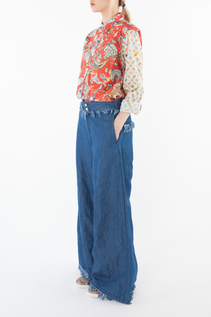 Wide denim pants with fringes