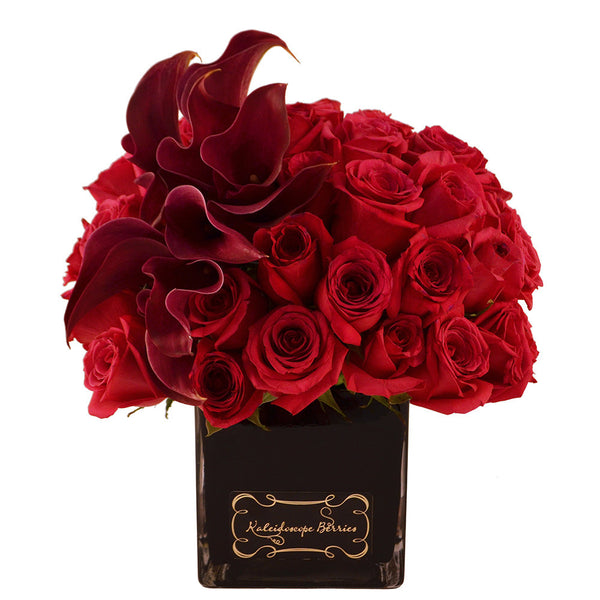Dozens of red roses and burgundy cala lilies in square cube black vase