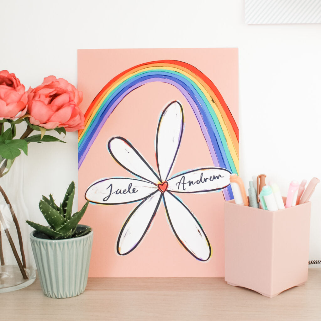 An image of one of Jade's personalised and illustrated prints featuring a flower and a rainbow