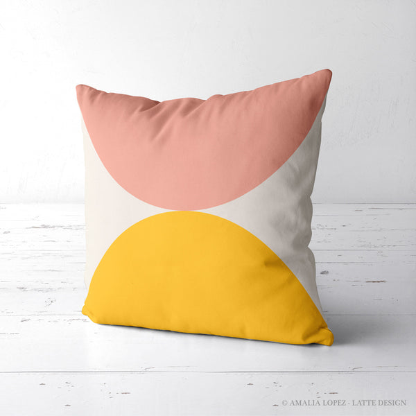2 circles. Pink and yellow geometric cushion