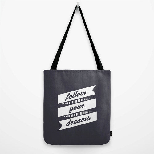 Follow your dreams. Black and white typography tote bag