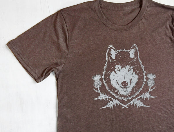 Brown organic cotton t shirt for men and women with screenprintng of a wolf and thistle flowers on the front