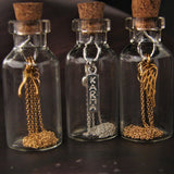 necklace, message in a bottle