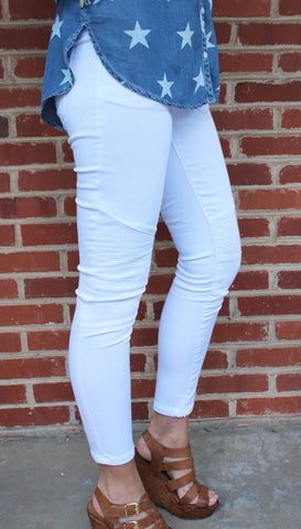 White Moto Jeggings- white denim high-waist stretchy jeggings with patchwork detail at the knee
