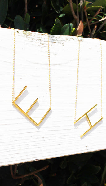 gold sideways initial necklaces
