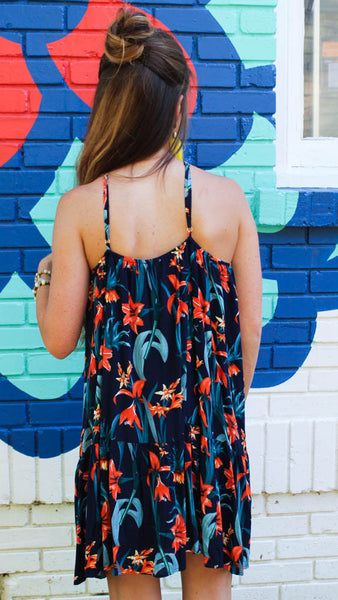 Hibiscus Halter- navy sundress with bright coral hibiscus floral print, halter neckline, and adjustable straps