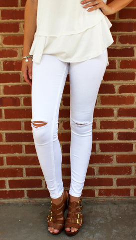 White Jeans- white denim mid-waist skinny jeans with ripped knee slits