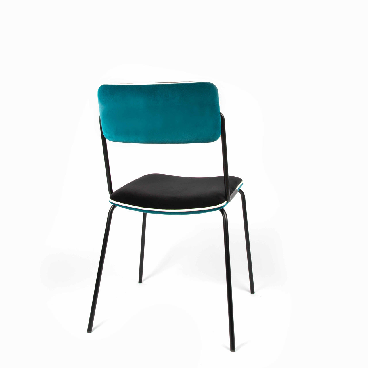 Maison Sarah Lavoine create their first dining chair Double Jeu. The chair's simple and airy silhouette is balanced by its soft curves and colourful velvet | colour:Sarah Blue and Black