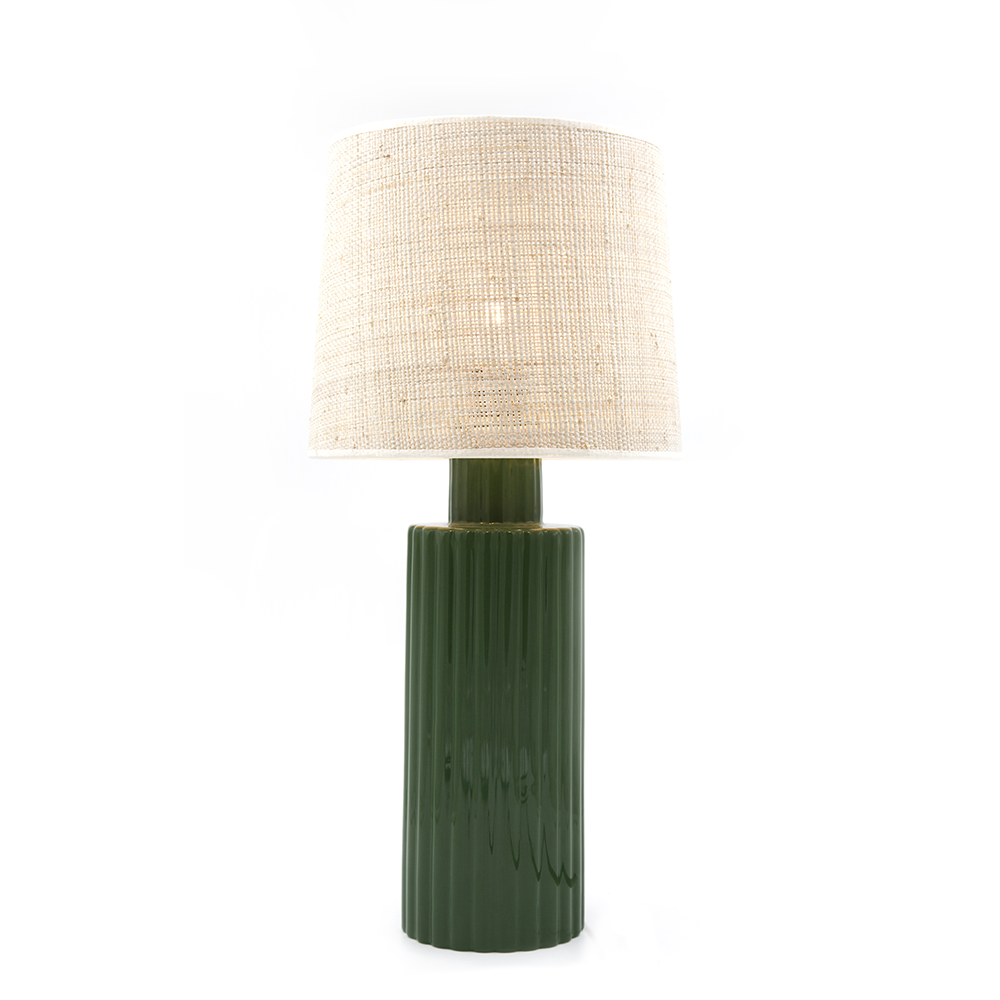 Table light designed by Maison Sarah Lavoine: ceramic base in olive green and rabane lamp shade bring a vintage touch. Simple shapes with character, graphic coloured lines for an understated chic |