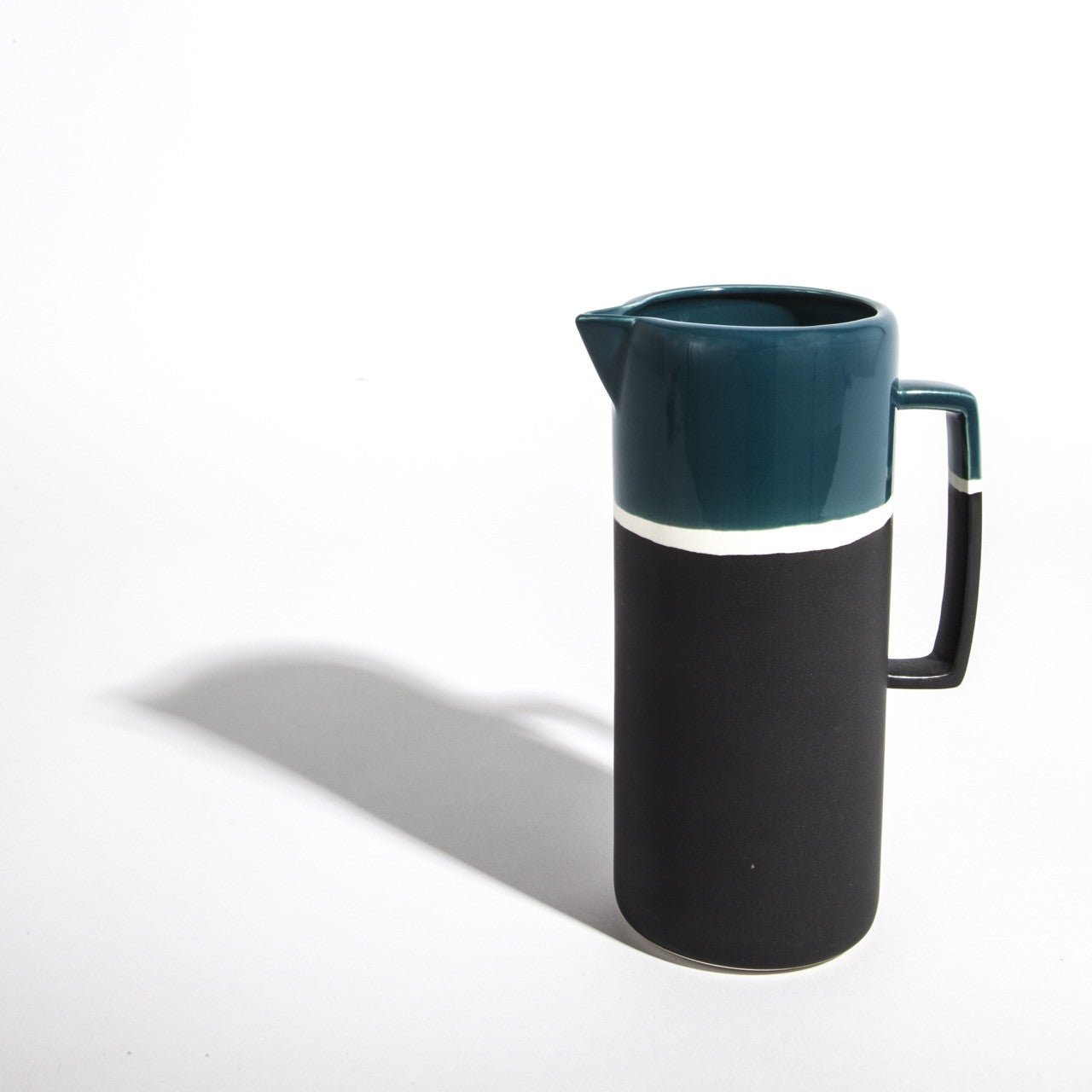 Graphic lines, deep colours and double finish effect matte and shiny, this retro-looking jug has been designed by Maison Sarah Lavoine and handmade traditionally by skilled artisans at Jars Ceramists in southern France.