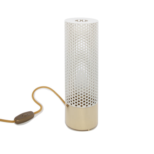 Designed by Sarah Lavoine for her recent project the Roch Hotel & Spa in Paris, the Sabine light is a simple and elegant perforated brass table light.