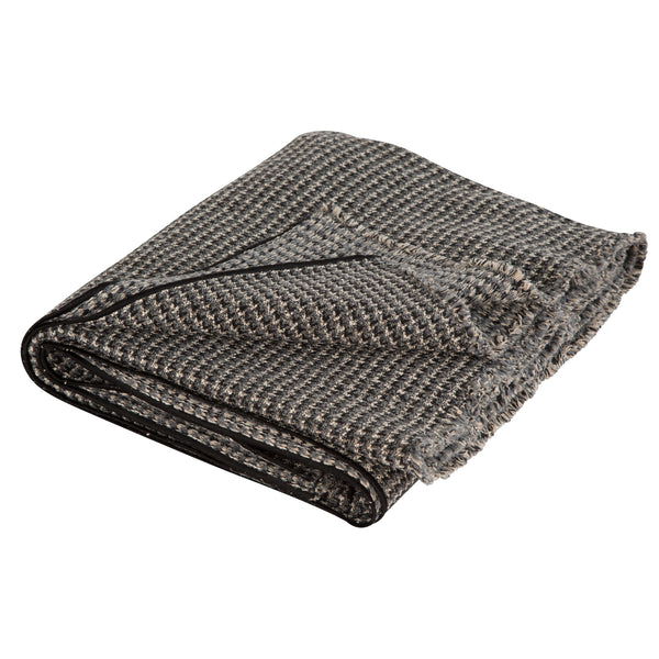 Maison de Vacances revisit classic houndstooth pattern on thick wool broadcloth and mottled tweed for these unique and luxurious throws.