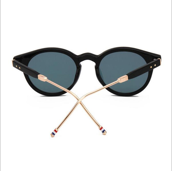 black sunglasses black and gold frame