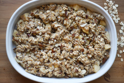healthy apple crisp before baking in white crock dish
