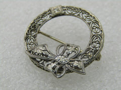 Early 1900's 14kt Filigree Diamond Brooch, Circle with Bow, 1""