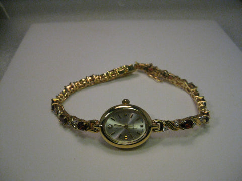 "Ladies Quartz Watch, with Garnet & CZ bracelet band,  8"", Japan Movement, Oval, 14kt. G.F."