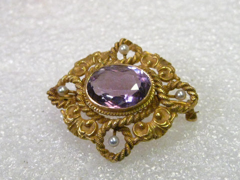 Early 1900's 14kt Gold Oval Amethyst & Seed Pearl Scrolled Rope Brooch, 2.25 ctw, 4 2mm pearls, 5.23 grams.