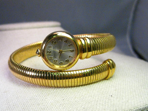 Vintage Joan Rivers Gold Tone Tubogas Wrapped Wristwatch, Vintage but also still current