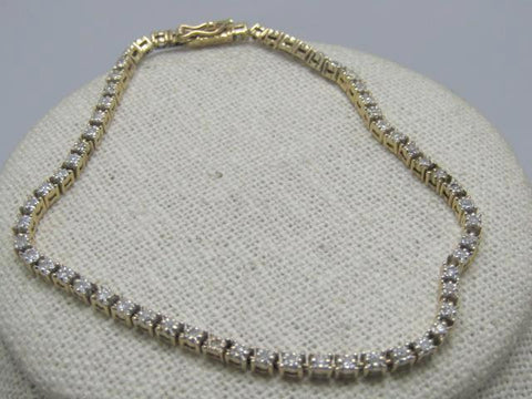 "Vintage 14kt Diamond Tennis Bracelet, 62 diamonds, 1.25ctw, 7.75"", Signed.  7.22 grams."
