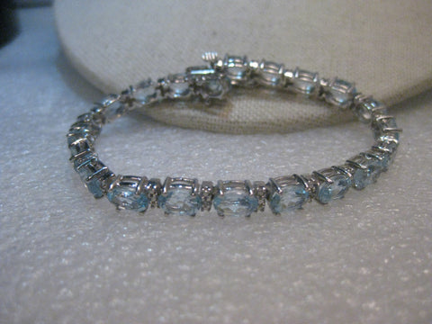"Sterling Silver Created Blue Topaz Tennis Bracelet, 7"", 15.75tcw, 15.31 grams, 5mm wide"