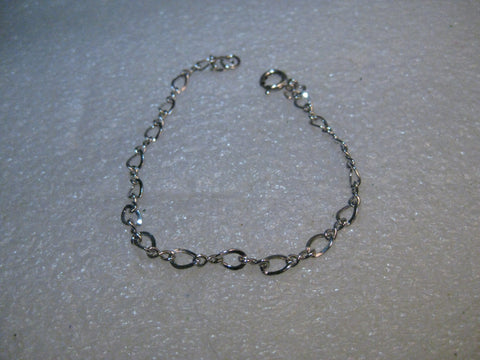 "Sterling Silver 7"" Charm Bracelet, 2.65 grams, 4mm wide."