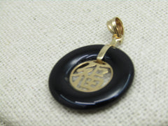 "14kt Open Onyx Chinese Blessing Pendant, 1-1/8"" by 3/4"", 1.81 grams, Red Silk Pouch"