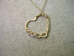 "10kt Yellow Gold Open Heart Pendant with 5 Graduated CZ's, 18"", JCM, 1.43 grams"
