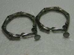 "Vintage 1970's/80's Silvertone Textured Bamboo Hoop Hinged Clip-On Earrings, 1.25"", signed Capri"
