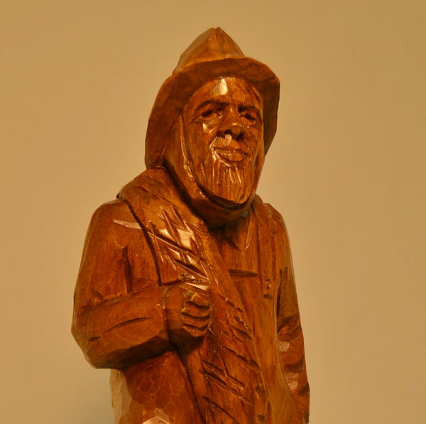 Fisherman with lobster trap wood carving