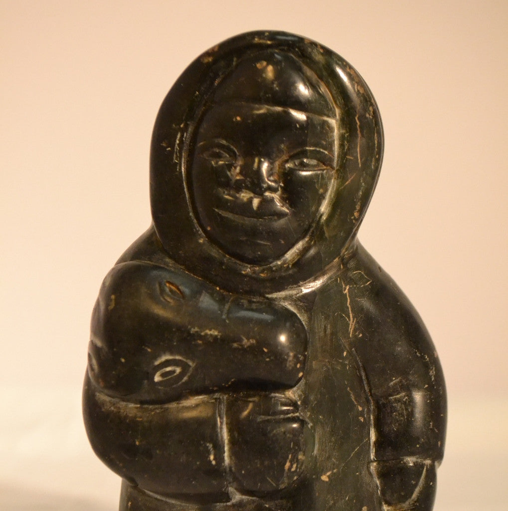 Hunter carrying bear head inuit carving