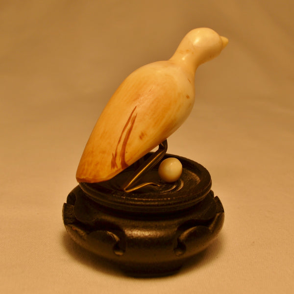 Miniature Inuit ivory water bird carving with egg