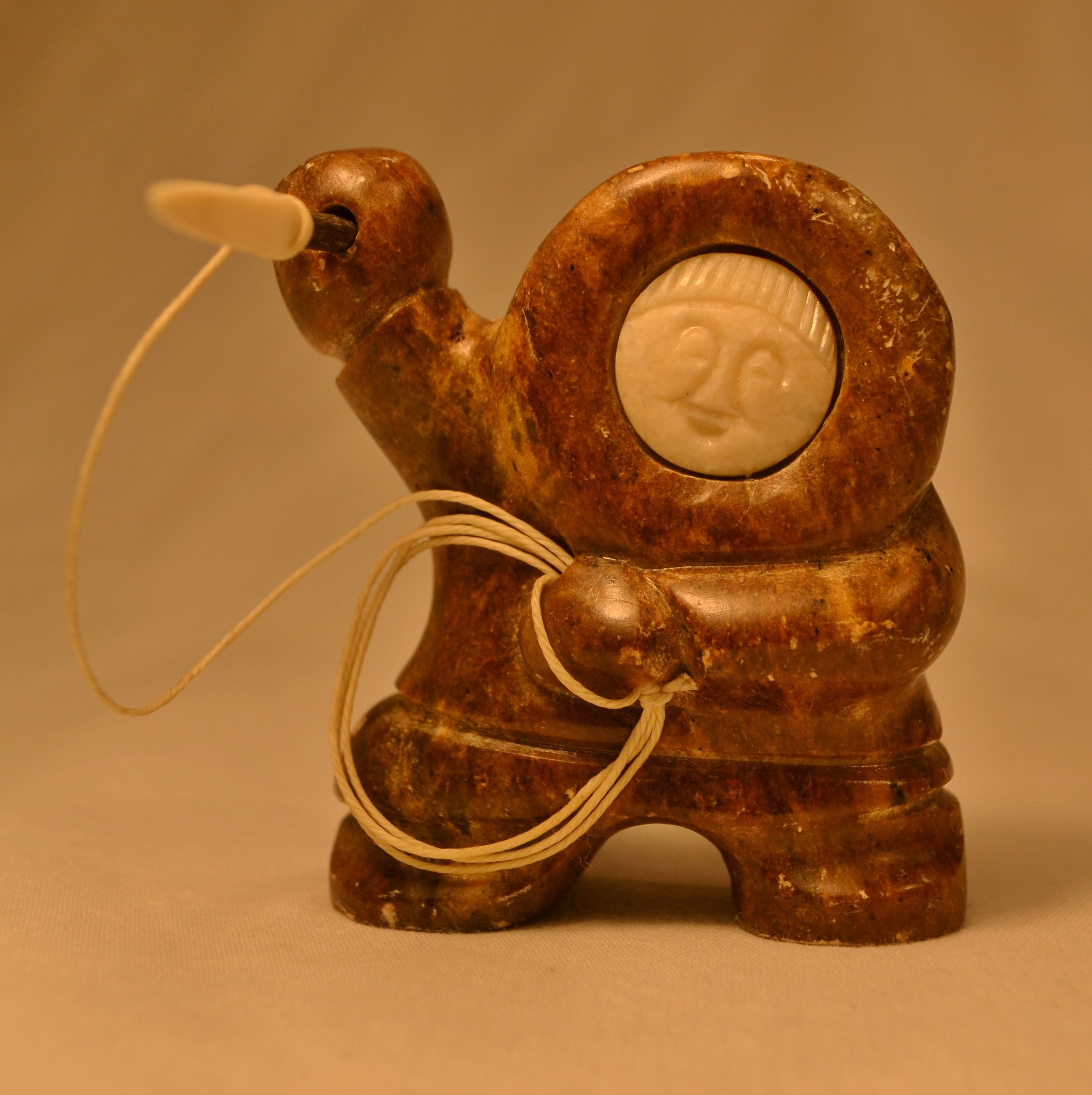 Miniature hunter with ivory face Inuit carving