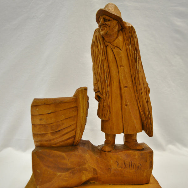 Fisherman with boat wood carving
