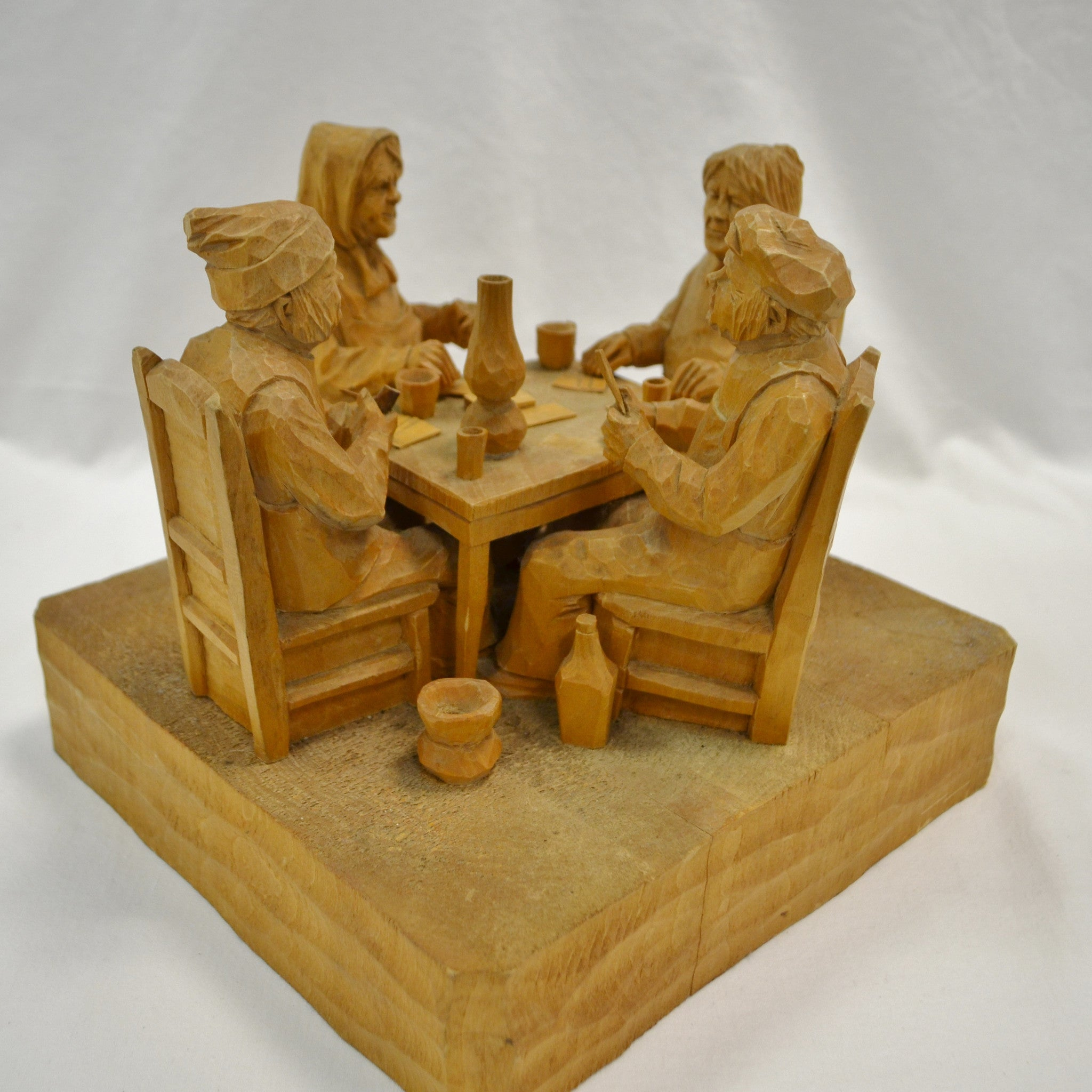 Four card players wood carving by Lucien Bourgault
