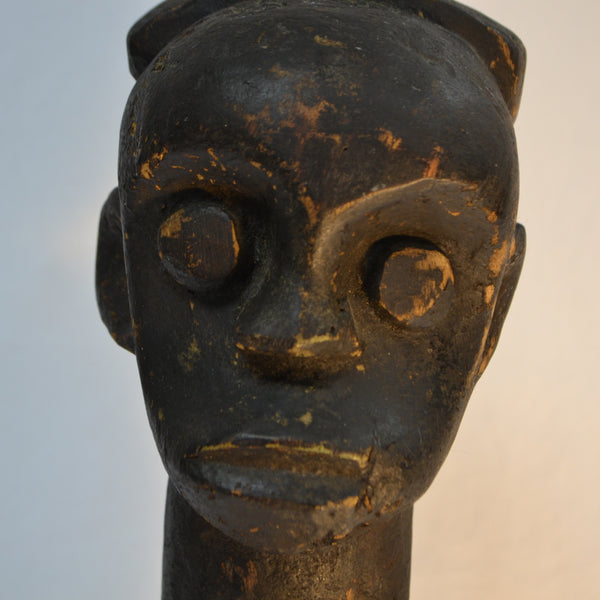 African belly button man wood carving face
