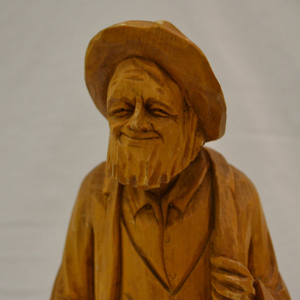 Old smiling man wood carving by Pelletier
