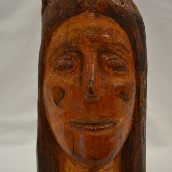 Indian face carved in branch folk art