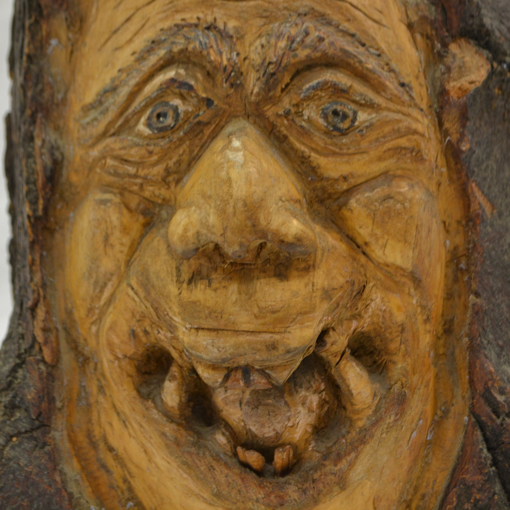 Stump man face folk art carving