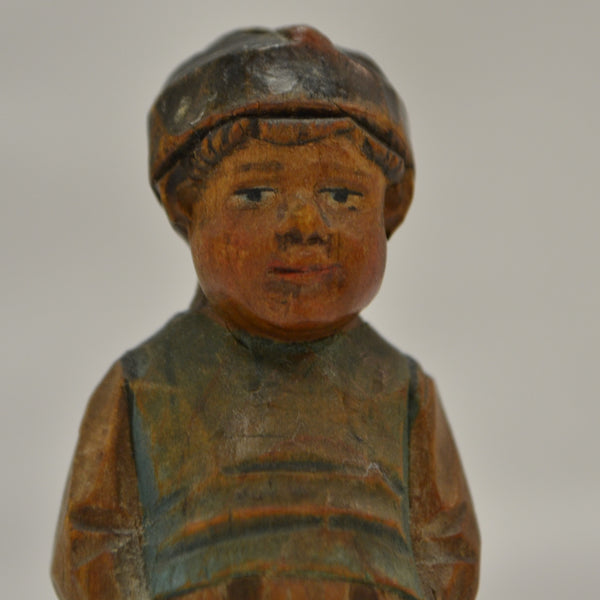 Little Boy with Backpack Folk Art Carving - face