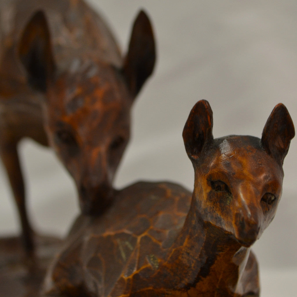Doe and Faun Folk Art Carving Close up