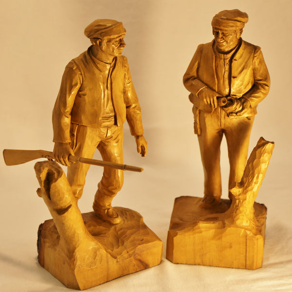 Two hunter carvings by Roger Bourgault