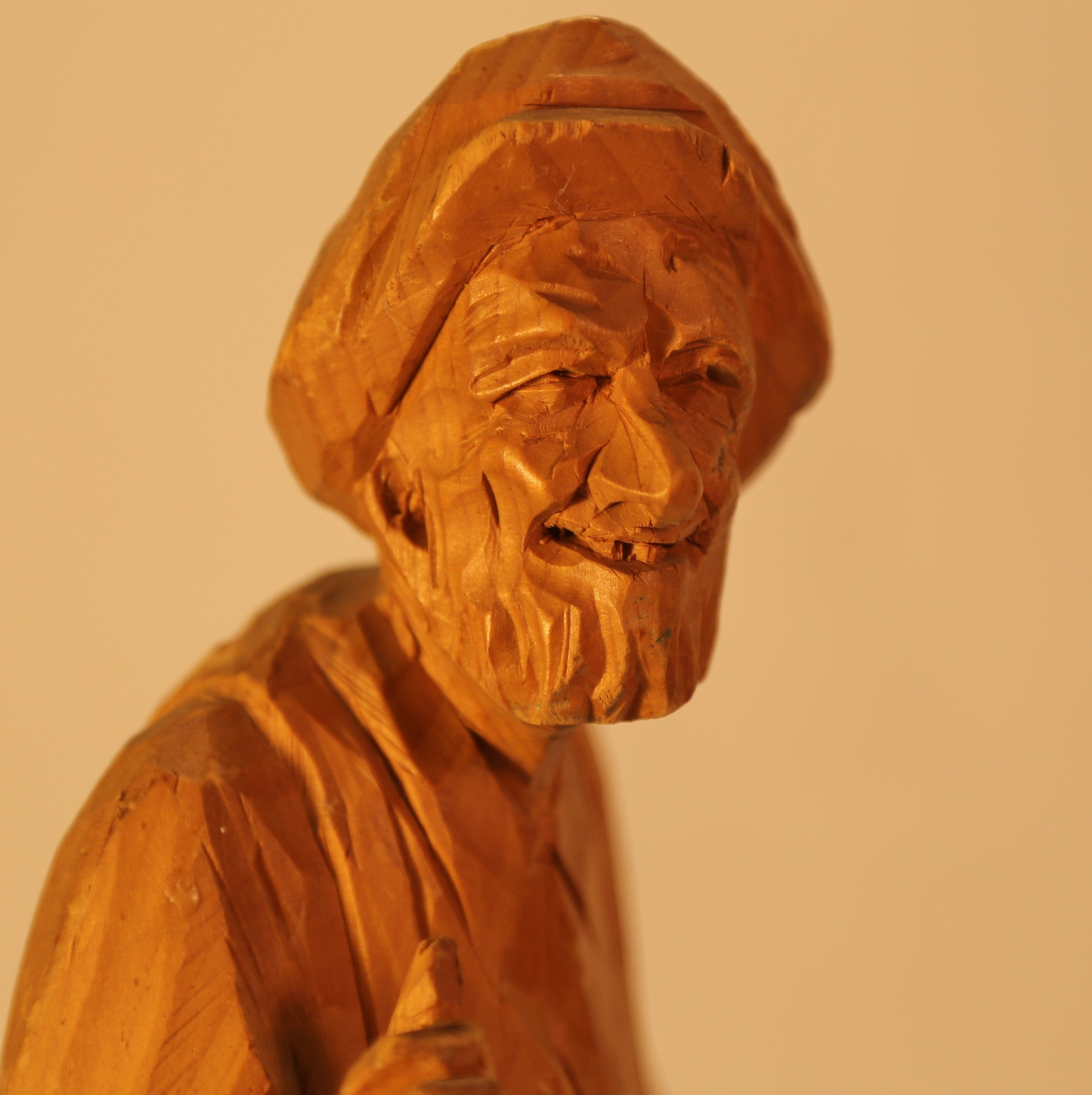Man wood carving by P.E. Caron