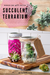 Two Mason jars, each with one succulent inside and decorated with twine, a handmade gift tag and a JarJackets silicone sleeve.