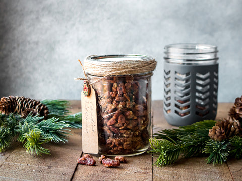 Candied pecans in a Mason jar decorated with twine and a homemade gift tag.