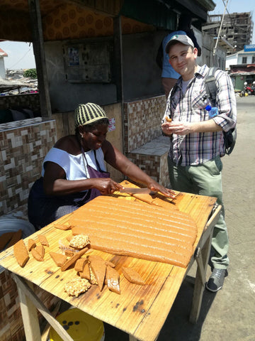 An artisan preparing Nkate, ​a ​delicious ​​peanut brittle