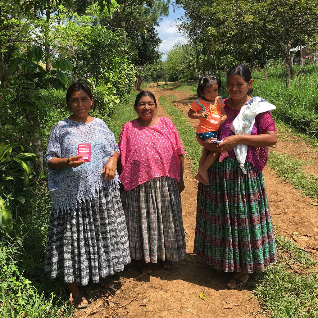 Three female farmers in the community about to enjoy our chocolate. Cacao production has traditionally been dominated by men, so much respect to these women pioneers!