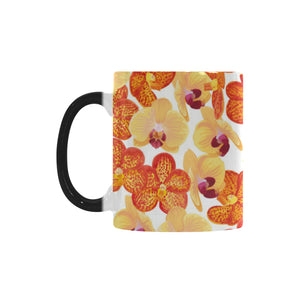Orange yellow orchid flower pattern background Morphing Mug Heat Changing Mug