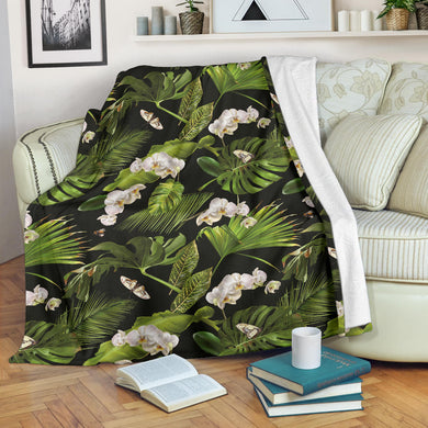 White orchid flower tropical leaves pattern blackground Premium Blanket